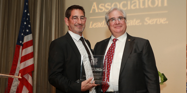 Richard Kaplan Receiving an Award from the BHBA